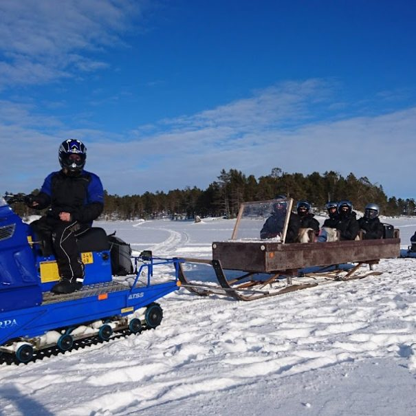 Ice Fishing on Lake Inari with Snowmobile and Sleigh