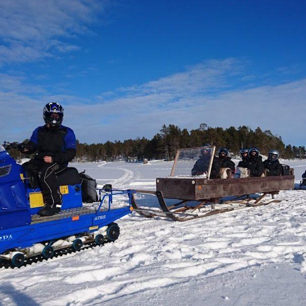 Ice Fishing on Lake Inari with Snowmobile and Sleigh